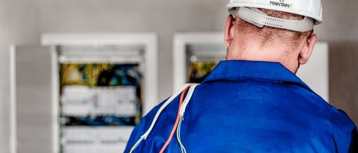 Commercial electrician on site doing electrical work